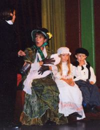 Young David with Mrs Micawber (Chrissie Neal) and the Micawber Children (Rebecca & Conor Feltham)