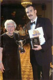 Richard Neal receives the Barbara Warde Cup from Evelyn Wakeford (photo courtesy of the Daily Echo)