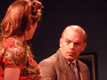 Clarissa (Lauren Homer) and Inspector Lord (Paul Dodman)