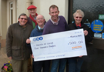 Sam Moulton presents a cheque for £500 to Friends of East Dorset CAB