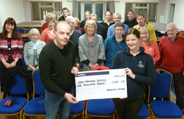 Paul Dodman presents cheque for £1000 to Sara Johnson from Lewis-Manning Hospice